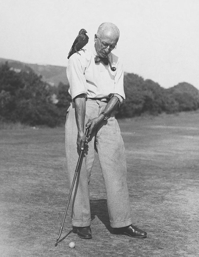 Golfer With His Pet Jackdaw, 1933